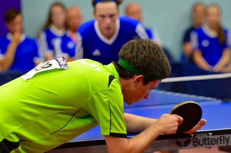 player about to serve in ping pong game