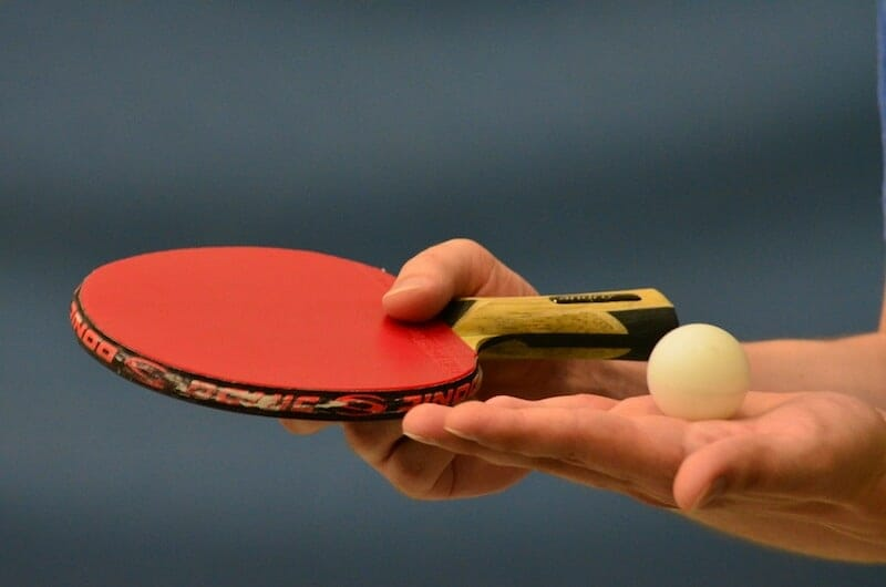table tennis bat and ball in serving position
