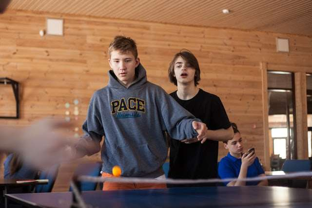 Playing table tennis with a doubles partner