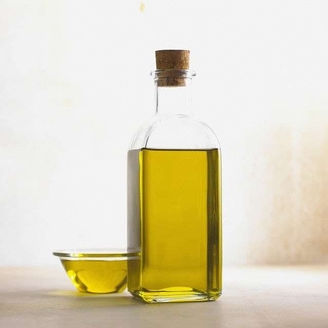 A bowl and bottle of oil