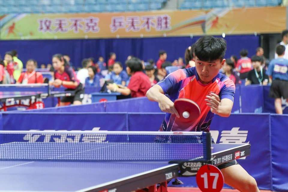 Player hitting a backhand in table tennis